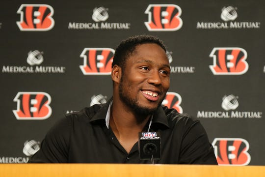 Cincinnati Bengals defensive end Carlos Dunlap answer questions after signing a three-year, $45 million contract extension through 2021 with the team, Wednesday at Paul Brown Stadium.