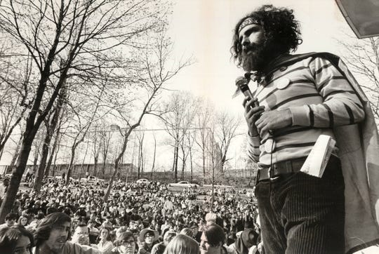 Yippie leader Jerry Rubin, wearing a Viet Cong flag as a cape, held a rally at Eden Park in 1969.