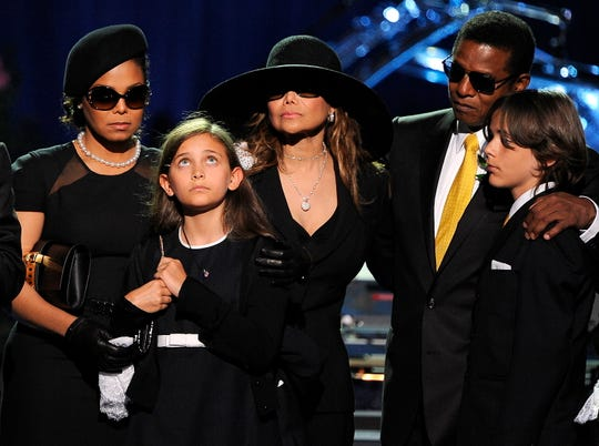 FILE - In this July 7, 2009 file photo, the Jackson family, from left, Janet Jackson, Paris Jackson, LaToya Jackson, Jackie Jackson and Prince Michael appear on stage at the memorial service for music legend Michael Jackson, at the Staples Center in Los Angeles. Michael Jackson died on June 25, 2009. (AP Photo/Gabriel Bouys, Pool File)