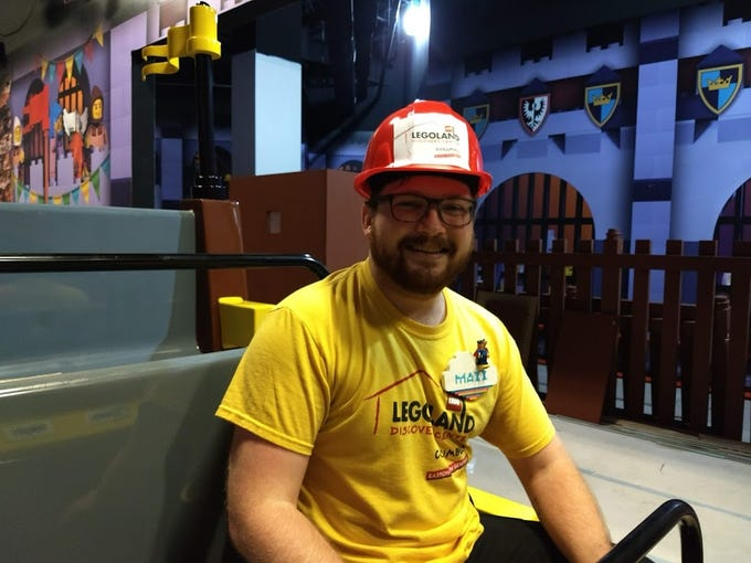 LEGOLAND Discovery Center Columbus master builder Maxx Williams sits Wednesday on the ride at the center.