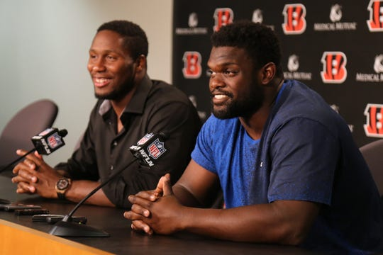 Cincinnati Bengals defensive tackle Geno Atkins, right, and defensive end Carlos Dunlap answer questions after they both signed contract extensions with the team, Wednesday at Paul Brown Stadium.