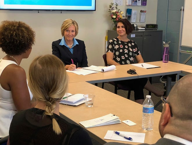 Democratic former U.S. Rep. Betty Sutton sits at a round table in Columbus, Ohio, on Tuesday, Aug. 28, 2018.