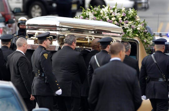 In this Feb. 18, 2012 file photo, the coffin containing singer Whitney Houston is carried to a hearse after funeral services at the New Hope Baptist Church in Newark, N.J. Houston died last Saturday at the Beverly Hills Hilton in Beverly Hills, Calif., at the age 48.