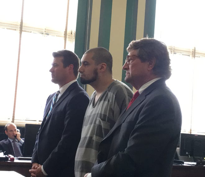 Gianfranco Marin stands between his attorneys, William Oswall (at left) and Thomas Koustmer (at right), as he prepares to plead guilty Wednesday in Hamilton County Common Pleas Court. Marin was sentenced to 18 years in prison for the death of his 2-year-old son.
