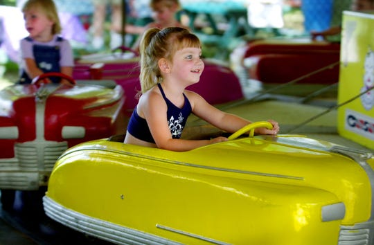 Taylor Ponder 4, of  Mount Healthy smiles while riding in a car ride at Stricker's Grove in 2001.