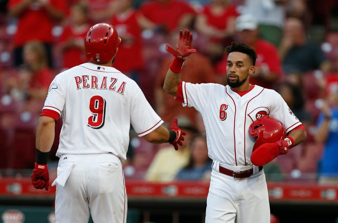 Cincinnati Reds' Jose Peraza (9) is congratulated on a two-run home run off Milwaukee Brewers starting pitcher Junior Guerra by Billy Hamilton (6) during the first inning of a baseball game, Tuesday, Aug. 28, 2018, in Cincinnati.