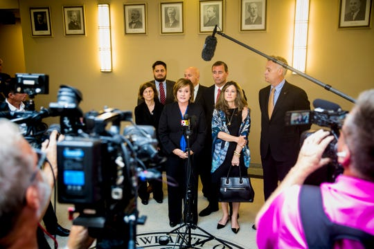 Commonwealth's Attorney Michelle Snodgrass answers questions from the media after Shayna Hubers was given a life sentence for the murder of Ryan Poston at the Campbell County Courthouse Wednesday, August 29, 2018 in Newport, Kentucky. Snodgrass stands next to her legal team and Ryan Poston's parents, Lisa and Peter Carter and Jay Poston.
