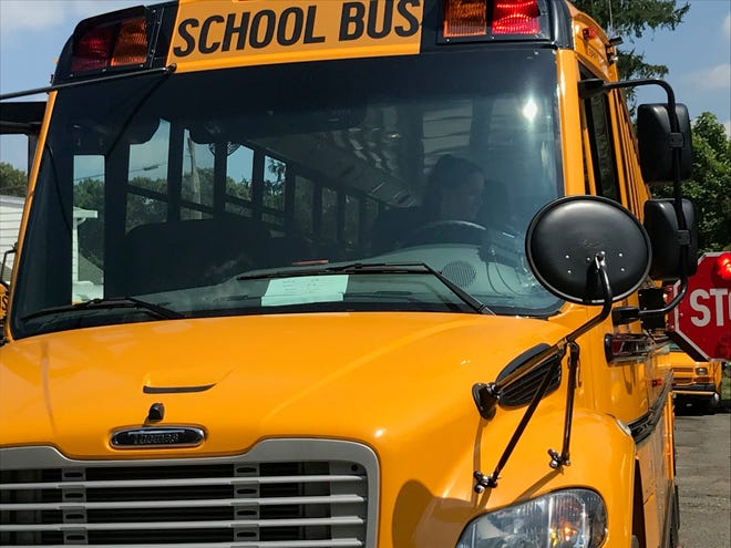 Children are being removed from a school bus that became stuck in a ditch in Hillsborough
