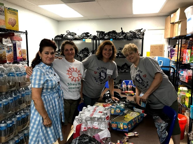 Mary Beth DeLisi, second from the right, went with five other members of St. Joseph Parish, through the Diocese of Metuchen, to volunteer at the Catholic Charities Rio Grande Valley Humanitarian Respite Center from Aug. 8 to 12. DeLisi helped put together snack bags for the refugees.