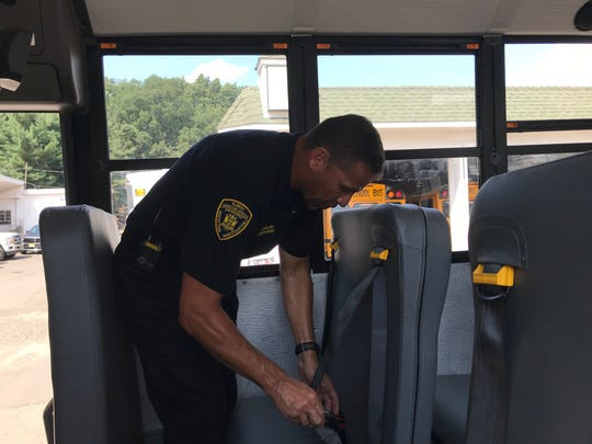 On Wednesday, New Jersey Motor Vehicle Commission Chair and Chief Administrator Sue Fulton, along with team members of the MVC's School Bus Inspection Unit, visited Irvin Raphael Inc. on Old Stage Road to conduct inspections of some of the company's fleet of 130 buses. MVC Safety Supervisor Ronald English inspects the three-point safety harness system on a bus.