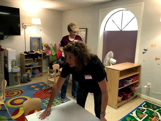 Mary Beth DeLisi wipes off a table at the end of the day at the Catholic Charities Rio Grande Valley Humanitarian Respite Center. She played with the kids a lot. She rolled Play-Doh, drove Matchbox cars and helped let the kids be kids.