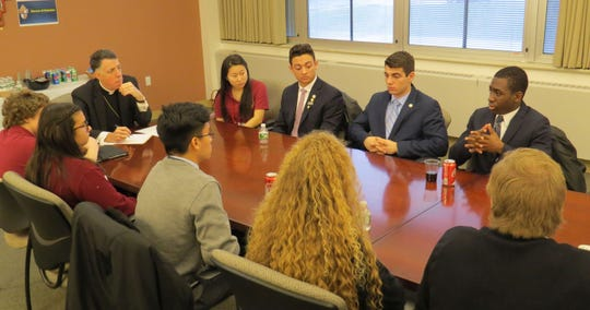 """Student leaders from the four Catholic high schools in the Diocese of Metuchen met with Bishop James F. Checchio on March 2 to discuss the issue of school gun violence. The meeting inspired the use of a new safety app called """"STOP!T."""""""