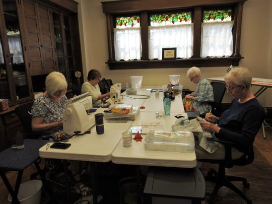 A group of women recently work on quilting and sewing projects at the Rose of Sharon Retreat. The home now owned by Vickie Davis and Jacque Wagner has been turned into a retreat for those who quilt and sew.