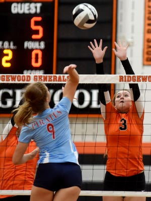 Morgan Matis goes up for a block against Brooklyn Frey during Ridgewood's 15-25, 25-19, 25-22, 25-18 win against visiting Garaway on Tuesday night.
