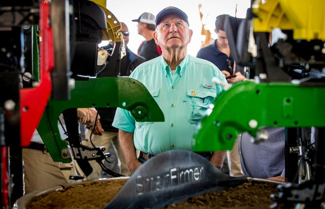 U.S. Secretary of Agriculture Sonny Perdue looks at a planting unit made by Precision Planting during a tour of the Farm Progress Show on Wednesday near Boone.