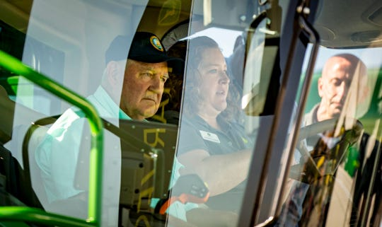 U.S. Secretary of Agriculture Sonny Perdue gets a tour of a John Deere combine cab at the Farm Progress Show Wednesday, Aug. 29, 2018, near Boone, Iowa.