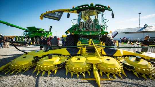 A corn harvester on display at the John Deere pavilion of the Farm Progress Show Aug. 29, 2018, near Boone, Iowa.