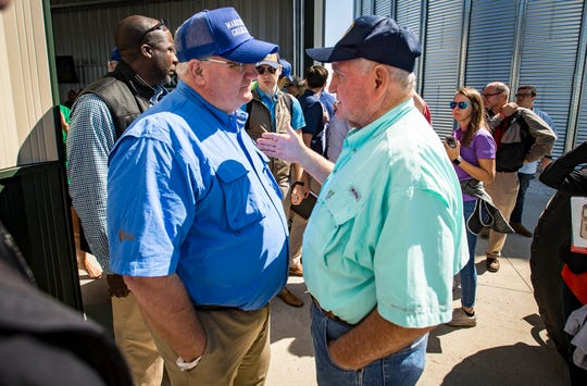 U.S. Secretary of Agriculture Sonny Perdue, right, talks with Kevin Skunes, president of the National Corn Growers Association at the Farm Progress Show on Wednesday near Boone.