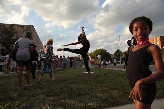 Alnur African Drum and Dance member Laila Gilchrist of Detroit dances outside of the Charles H. Wright Museum of African American History in Detroit on Tuesday, August 28, 2018 as people line up to pay respects to the late Aretha Franklin during the first day of public viewing.