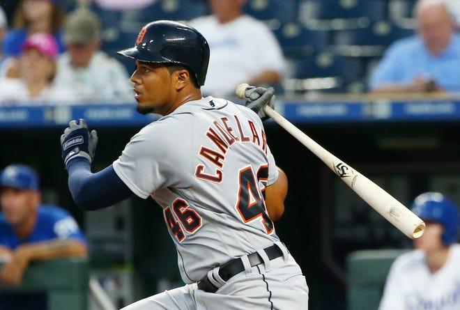 Detroit Tigers third baseman Jeimer Candelario (46) hits a sacrifice fly against the Kansas City Royals in the third inning at Kauffman Stadium on Aug. 28, 2018.