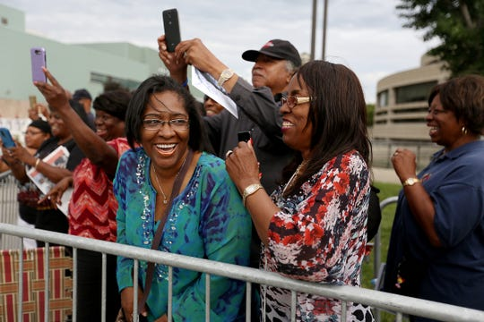 Angie Manning, 56, and her cousin, Regina Taylor, 72, both of Farmington Hills, joke around while waiting in line on the second day of a public viewing for Franklin at the Charles H. Wright Museum of African American History in Detroit on Wednesday, Aug. 29, 2018.