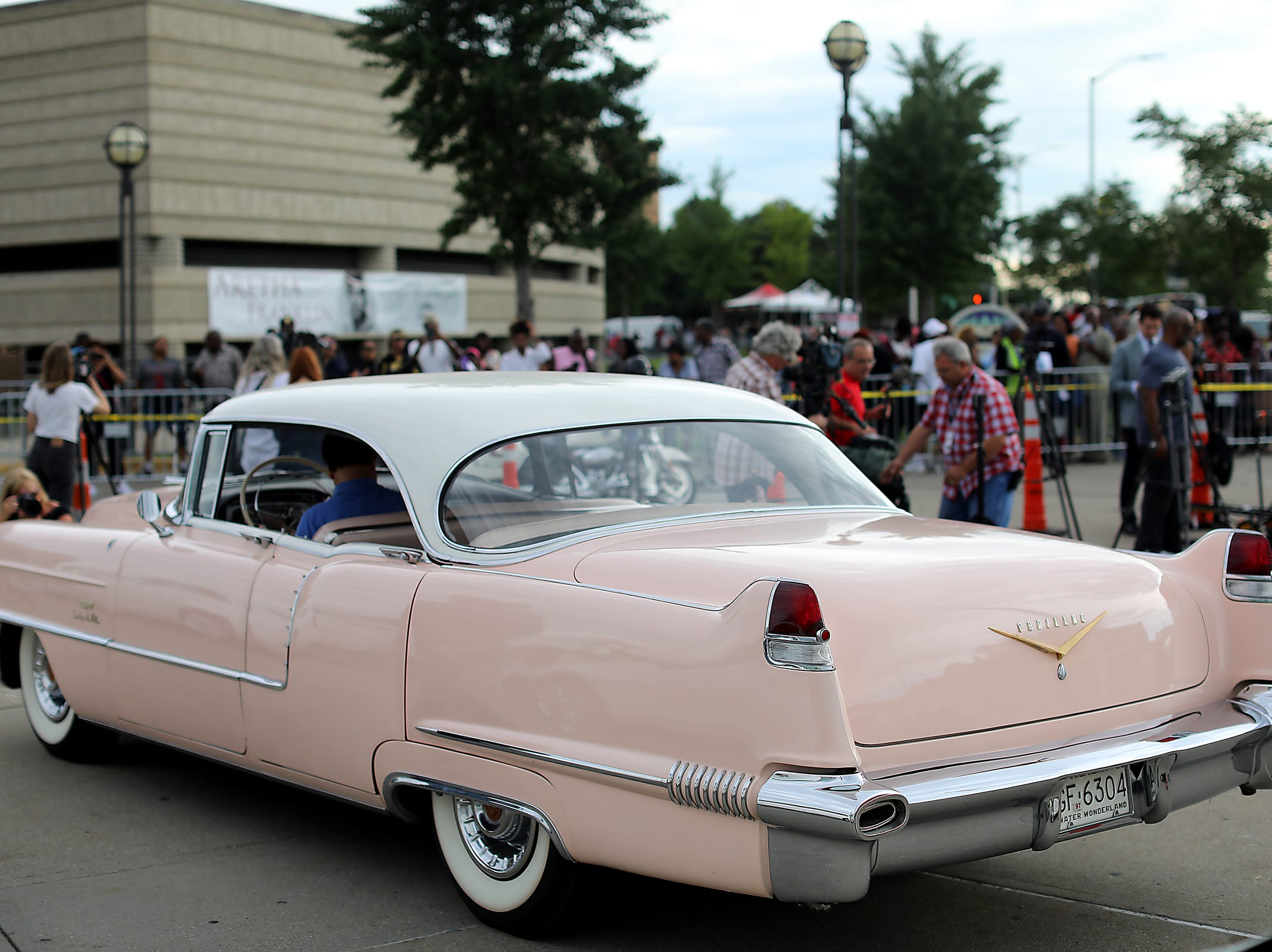 Stuart Popp's 1956 Cadillac Sedan deVille pulls in to the circle drive on the second day of a public viewing for Franklin at the Charles H. Wright Museum of African American History in Detroit on Wednesday, Aug. 29, 2018.