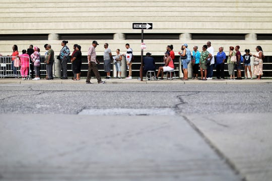 People wait in line on the second day of a public viewing for Franklin at the Charles H. Wright Museum of African American History in Detroit on Wednesday, Aug. 29, 2018.
