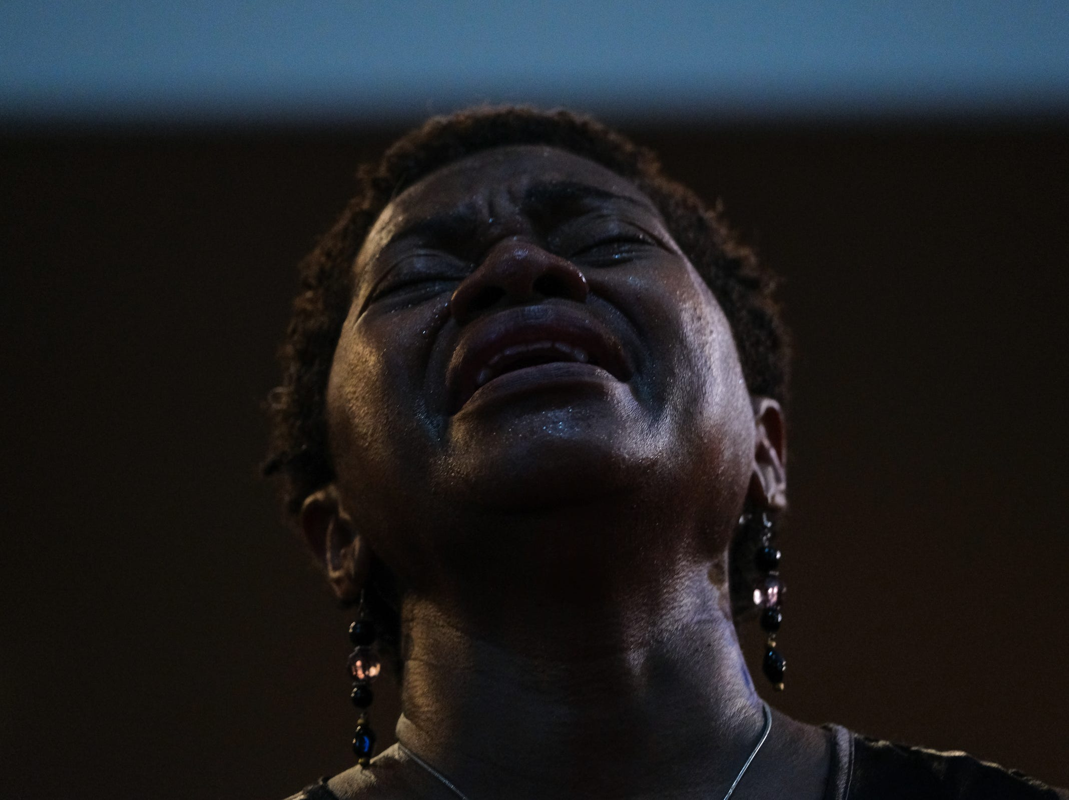 Avis Doughton of Detroit gets emotional as a speaker talks during a gospel tribute concert for the late Aretha Franklin at New Bethel Baptist Church in Detroit on Monday, August 27, 2018.