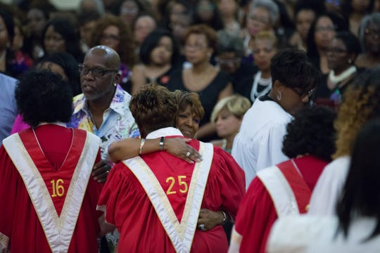 Family and friends of Aretha Franklin take part in the Delta Sigma Theta Sorority, Inc.'s Omega Omega service for Franklin at the Charles H. Wright Museum of African American History in Detroit on Tuesday, August 28, 2018.
