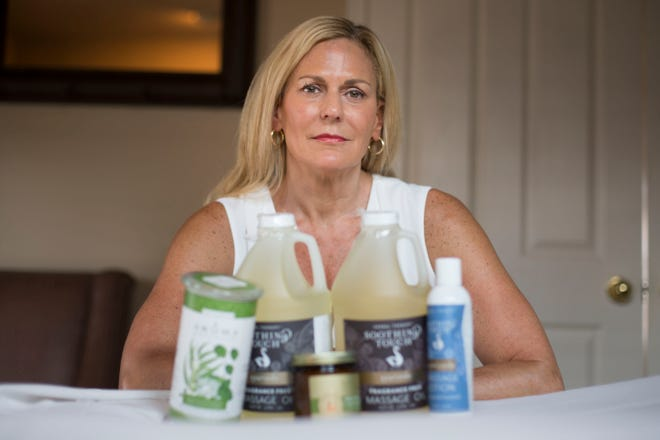 Diane Pineault, a massage practitioner and owner of Healthy Connections in Windsor, Ontario, uses a variety of massage oils and candles she imports from the United States for her business. the products face an added 10 percent tariff because of U.S.-Canadian trade tensions.