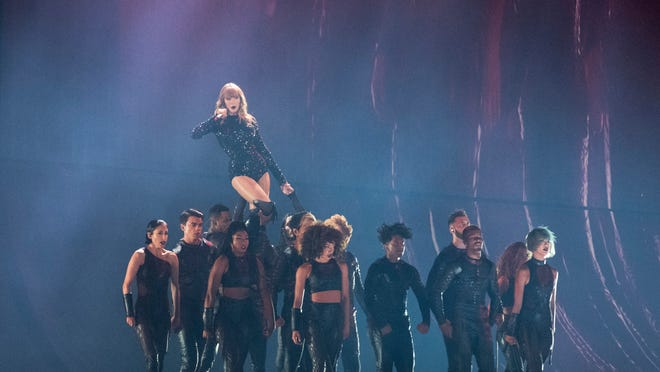 Taylor Swift Piles On Charm At Ford Field Concert