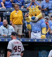 Kansas City Royals mascot Sluggerrr waves goodbye to Detroit Tigers pitcher Buck Farmer after he was relieved in the fifth inning on Wednesday, Aug. 29, 2018 at Kauffman Stadium in Kansas City, Mo.