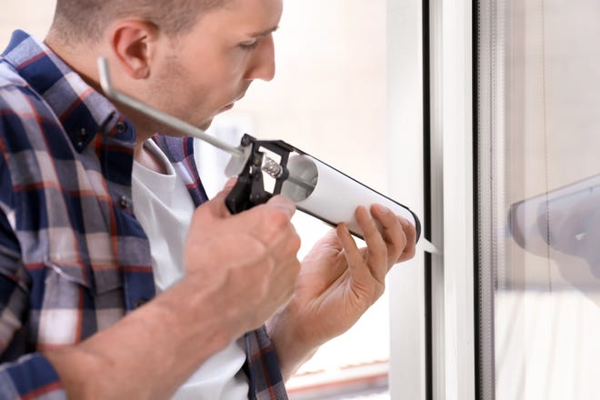 Sealing up windows with caulk is an easy and effective way to prevent drafts. (Dreamstime)