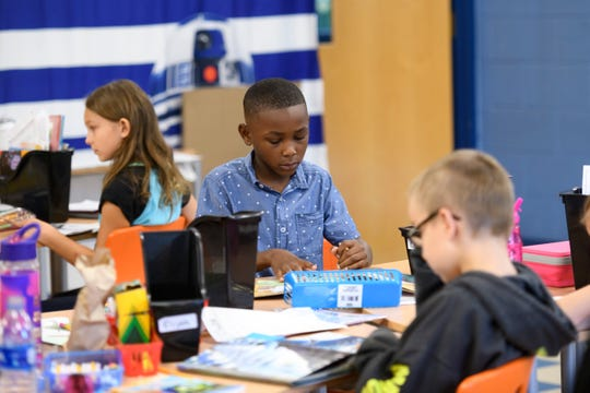 Third-graders read books in class at Madison Heights Elementary School on Wednesday.