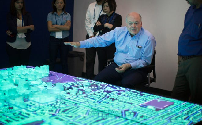 Ford CEO Jim Hackett talks with workers at the Innovation Drive and Technology Expo at the American Center for Mobility at Willow Run Monday, August 27, 2018.