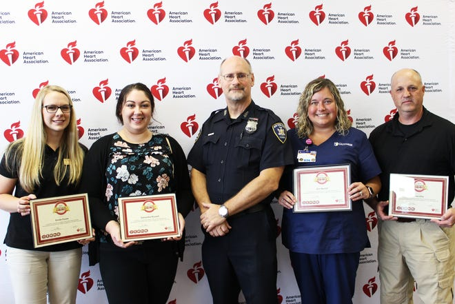 The American Heart Association this week honored four people for saving the life of William Wood, whose heart stopped while he was shopping in the Elmira Wegmans. From left are Emilie Couse, Samantha Rousell, Wood, Erin Herrick, and Brian Ellis.