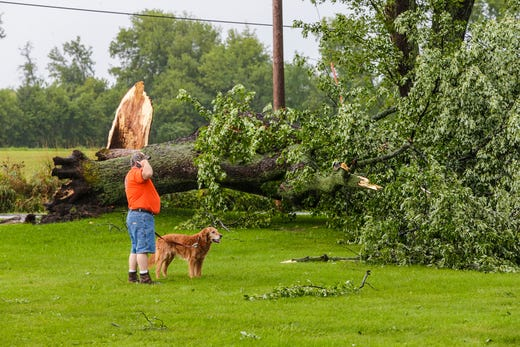 Dave Vande Zande speaks on Tuesday, August 28, 2018, while looking at trees were knocked down by strong winds in his home on N3367 Center Road northeast of Waupun, Wisconsin. In the afternoon, there was heavy rain in Fond du Lac County with a possible tornado in some places.