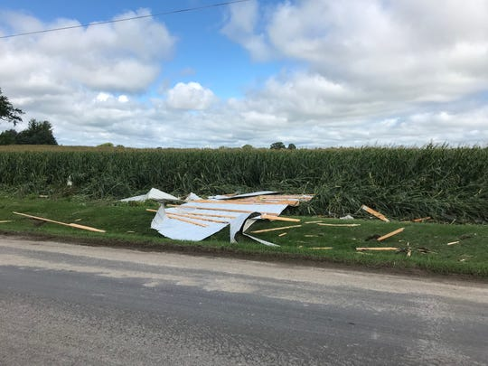Debris from the Wetzel farm stretched down Hemp Road, with employees and other helpers assisting in moving them back to one central area.