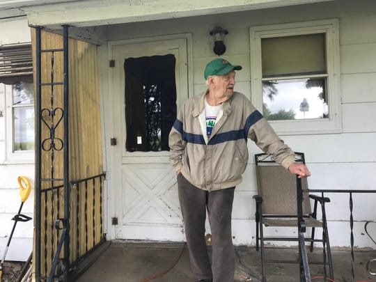 Glenn Kalkoff, 90, surveys the damage around his home in Byron.