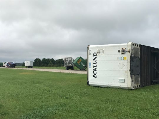 Semi-truck trailers knocked over at Quad Graphics