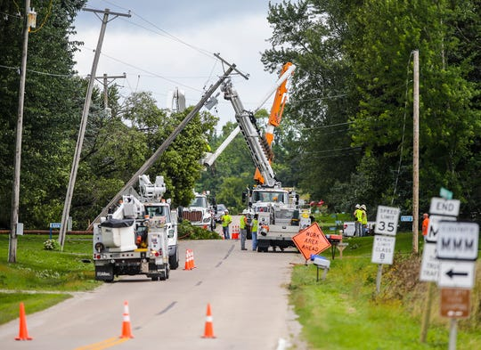 Crews work on power lines Wednesday on Savage Road near Waupun. Severe weather Tuesday afternoon raked across the Waupun area causing widespread damage.