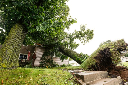 A tree fell on a house Tuesday, Aug. 28, 2018 at 409 Fond du Lac Ave. in Waupun, Wisconsin. Severe weather raked across Fond du Lac County during the afternoon with a possible tornado touching down in some locations.