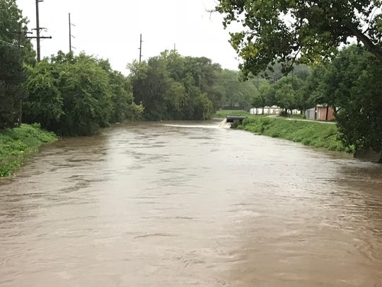 The Fond du Lac River rose Tuesday, Aug. 28, by Doty Street in Fond du Lac as storms pummeled the county.