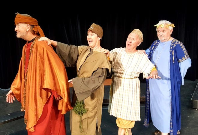 """Erronius (Keith Robinson) leads the way followed by Heidi Sarvis-Sapp (Hysterium), Jimy Forman (Pseudolus), and Ric Hills (Senex) during a rehearsal of """"A Funny Thing Happened on the Way to the Forum,"""" which opens on Sept. 7."""