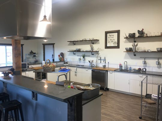 The Farm Fusion cooking studio teaches cooking classes inside of a red barn.