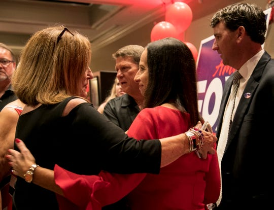 Rita Miller congratulates Amira Fox on her win in the primary race for State Attorney for the 20th Judicial District on Tuesday night.