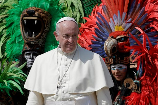 Pope Francis poses for photos with a group from Mexico wearing traditional clothes, during his weekly general audience, at the Vatican, Wednesday, Aug. 29, 2018.