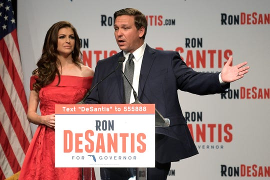 Florida Republican gubernatorial candidate Ron DeSantis, right, speaks to supporters with his wife, Casey, at an election party in Orlando after winning the Republican primary on Tuesday, Aug. 28, 2018.