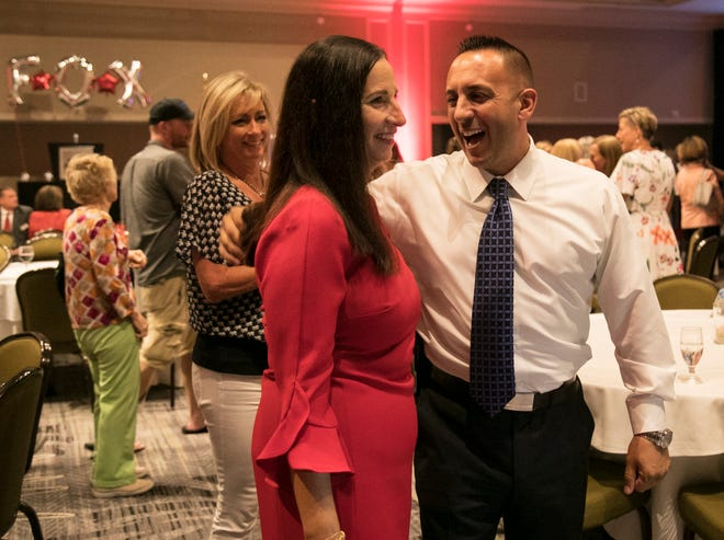 Undersheriff Carmine Marceno congratulates Amira Fox during her election night party on Tuesday night. She won the primary race for State Attorney for the 20th Judicial District over Chris Crowley.