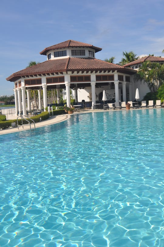 This 10,000-square-foot zero-edge infinity pool and club at Miromar Lakes.